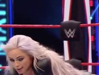 WWE - Liv Morgan on her knees in the ring