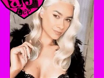 AJ Lee shows her blonde hair wig with chin mole